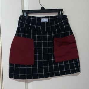 Black and white grid skirt with Burgundy pockets